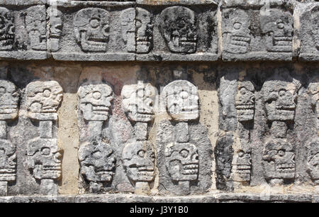 Bas-relief carving with human skulls on Tzompantli (Wall of Skulls), Skull Rack Temple, pre-Columbian Maya civilization, - Stock Photo