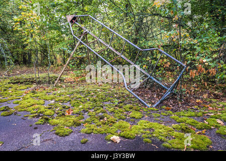 Playground in Pripyat ghost city of Chernobyl Nuclear Power Plant Zone of Alienation around nuclear reactor disaster - Stock Photo