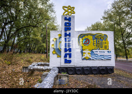 Welcome sign of Chernobyl town in Chernobyl Nuclear Power Plant Zone of Alienation around nuclear reactor disaster - Stock Photo