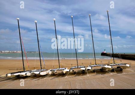 Little sailing catamarans on the beach of Les Sables d'Olonne, commune in the Vendée department in the Pays de la - Stock Photo