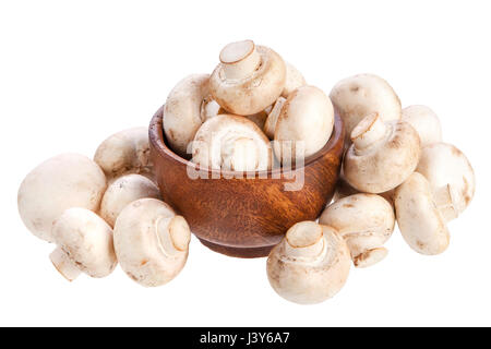 Mushroom champignon in wooden bowl isolated on white background