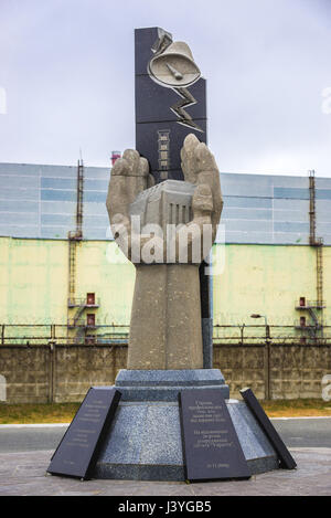 Monument to the Chernobyl Victims in front of Chernobyl Nuclear Power Plant in Zone of Alienation, Ukraine - Stock Photo