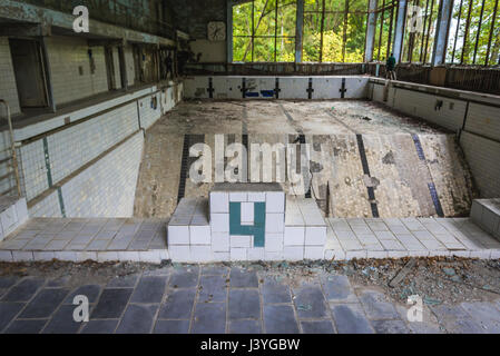 Swimming pool 'Lazurny' (Azure) in Pripyat ghost city of Chernobyl Nuclear Power Plant Zone of Alienation around - Stock Photo
