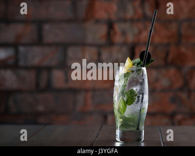 A mojito alcoholic cocktail seen on a table in a bar. - Stock Photo