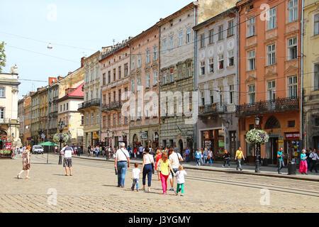 LVIV, UKRAINE - JUNE 15, 2015: Market (Rynok) square of Lviv - the central square and most popular touristic place - Stock Photo