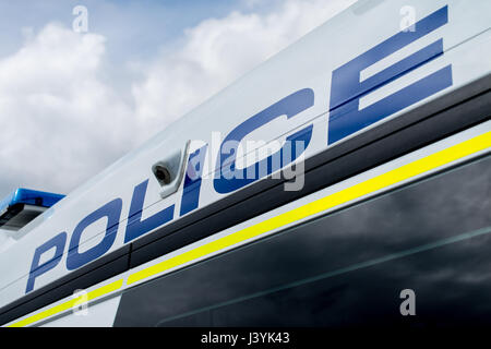Police Sign On Patrol Vehicle - Stock Photo