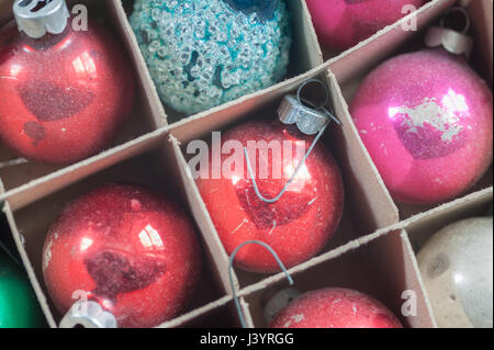 Box of christmas ornaments found in an antique store - Stock Photo