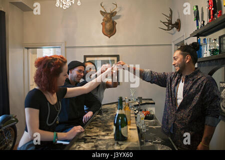 Group of friends at a bar. - Stock Photo