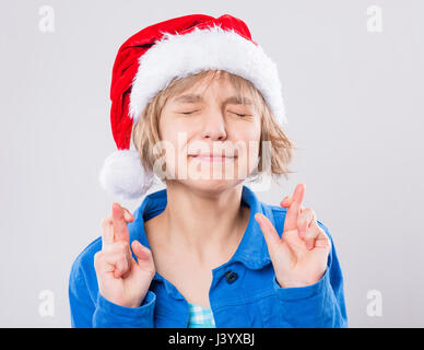 Little girl in santa hat - Stock Photo