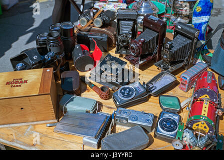 Old folding cameras, light meters and assorted bits of bric-a-brac on a stall in the Grassmarket, Edinburgh, Scotland, - Stock Photo