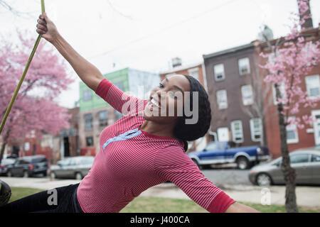 Woman on tire swing. - Stock Photo