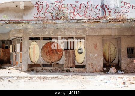 Abandoned building with murals in Havana, Cuba - Stock Photo