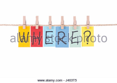 Where, Colorful words hang on rope by wooden peg - Stock Photo