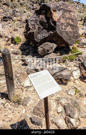 An interpretive sign of Boca Negra Canyon petroglyphs at Petroglyph National Monument, New Mexico, United States - Stock Photo