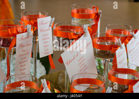 guest's names cards at wedding diner tables - Stock Photo