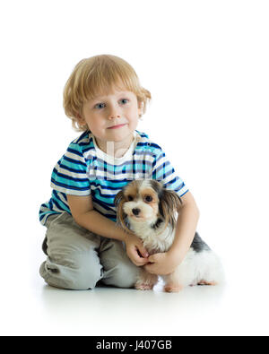 child and yorkshire terrier. isolated on white background - Stock Photo