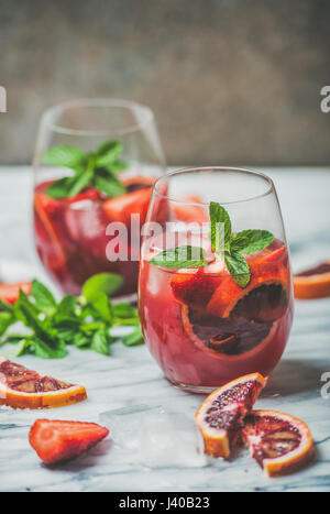 Blood orange and strawberry summer Sangria on marble table - Stock Photo