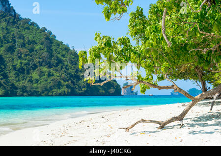 Scenic View of tropical island beach Against coast - Stock Photo