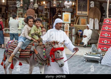 Qatar Doha Souk , children on donkey - Stock Photo