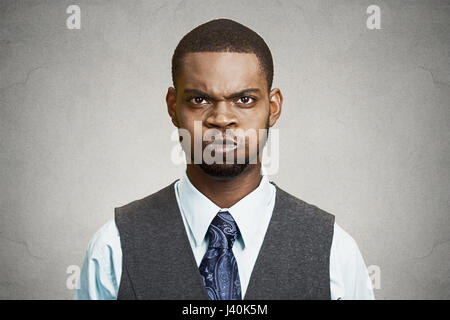 Closeup portrait angry young business man, blowing steam, about to have nervous atomic breakdown, isolated black - Stock Photo