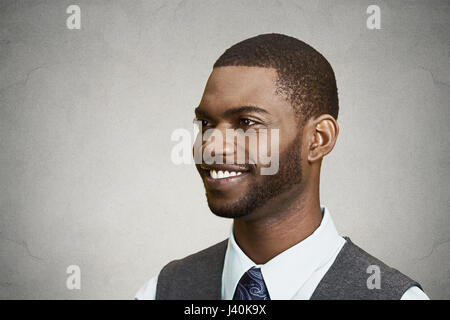 Closeup side view portrait, headshot, handsome happy, young business man, confident student, real estate agent, - Stock Photo