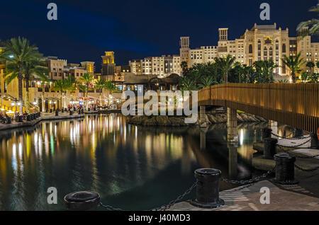 Night view of the artificial canal, Souk Madinat Jumeirah on the Arabian Gulf. Dubai, United Arab Emirates. - Stock Photo