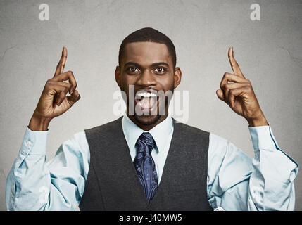 Closeup portrait young business man pointing up  having idea, solution, showing with index finger number one, isolated - Stock Photo