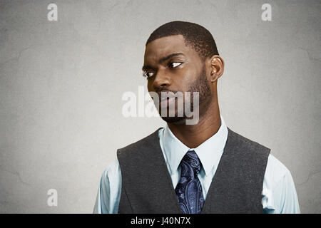 Closeup portrait, headshot angry, annoyed handsome business man avoiding eye contact, tired of fruitless conversation - Stock Photo