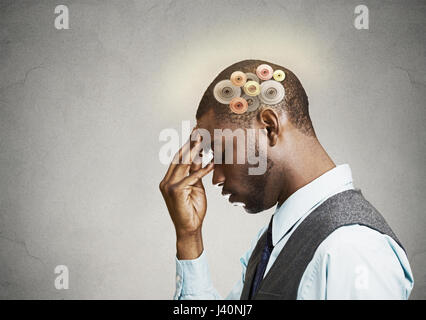 Closeup side view profile headshot thoughtful man, young guy thinking hard, gear mechanism, illustration over head - Stock Photo