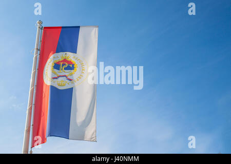 Flag of the Serb Republic of Bosnia (Republika Srpska) with its official coat of arms. The Republic of Srpska is - Stock Photo