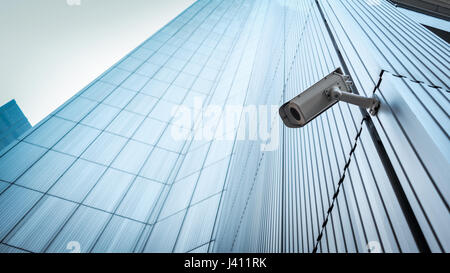 Outdoor CCTV Security camera installed on the building wall in the city - Stock Photo