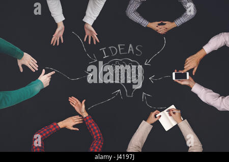 Teamwork concept - top view of six people generate ideas. - Stock Photo