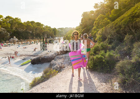 tourist with air mattress at the beach, Cala Sa Nau, Mediterranean Sea, near Portocolom, Majorca, Balearic Islands, - Stock Photo