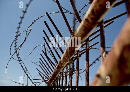 Barbed wire of the border fence between Israel and Lebanon, Rosch haNikra, Naharija, Israel - Stock Photo