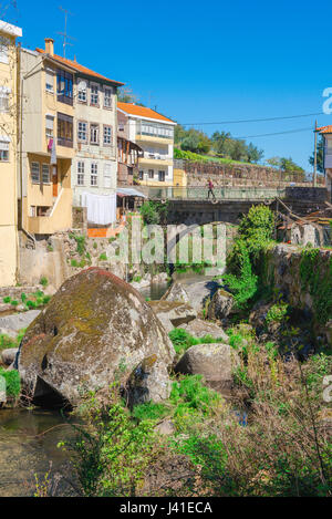 Lamego Portugal town, view of the south side of Lamego town in Portugal showing the medieval bridge spanning the - Stock Photo