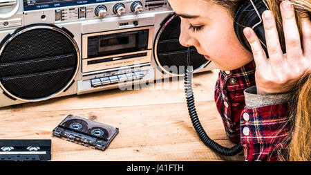 Retro styled music header with girl listening to ghetto blaster - Stock Photo
