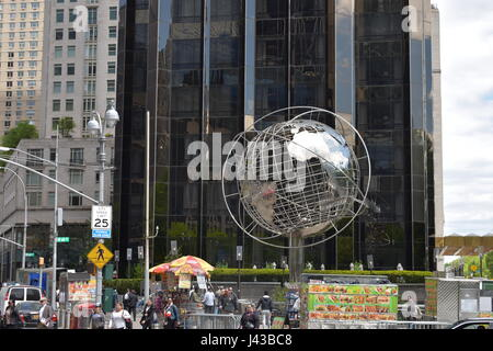 Globe at Columbus Circle is A Steel Globe with the 7 Continents of the World Surrounded by 3 Outer Steel Rings representing - Stock Photo