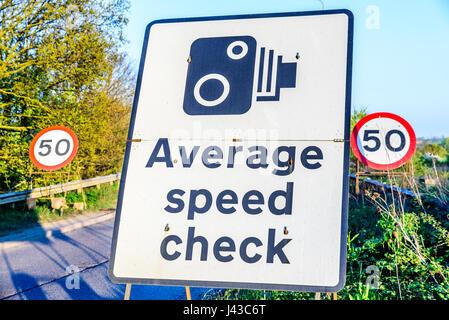 50 limit average speed check signpost UK Motorway exit. - Stock Photo