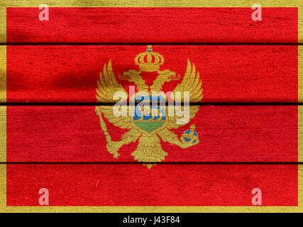Illustration of Montenegro flag over a wooden textured surface - Stock Photo