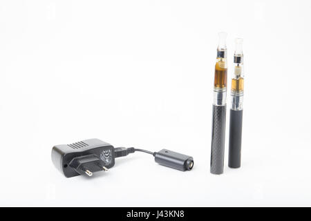 Thin black electric cigarettes with USB  charger - Stock Photo