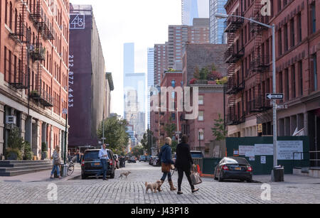 Local residents walking in the upscale, downtown neighborhood of Tribeca in New York City, NY, USA.  One of the - Stock Photo