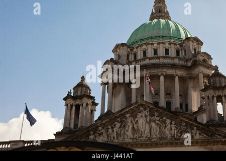 Belfast City Hall, UK. 9th May 2017. Europe and Union flags fly over Belfast City Hall in commemeration of Europe - Stock Photo