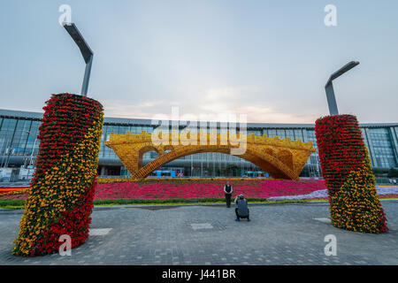 Beijing, China. 9th May, 2017. People pose for photos with the 'Golden Bridge on Silk Road' structure outside the - Stock Photo