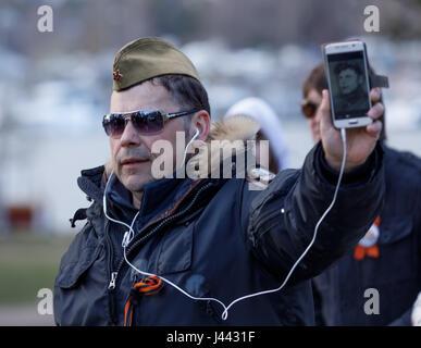 Helsinki, Finland. 9th May, 2017. Demonstrator wearing Soviet style military cap celebrating the anniversary of - Stock Photo