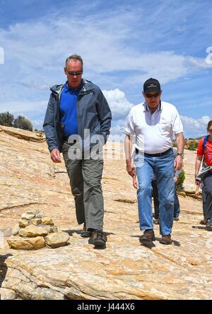 U.S. Secretary of the Interior Ryan Zinke, left, hikes with Utah Gov. Gary Herbert along the Butler Wash Indian - Stock Photo