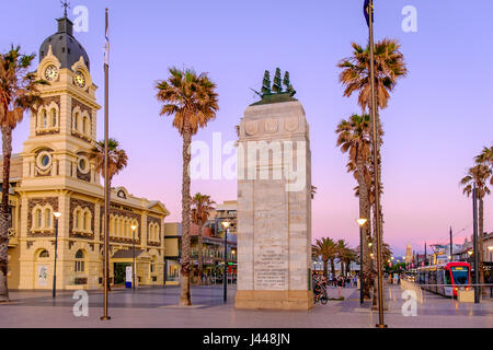 Adelaide, Australia - November 11, 2016: Moseley Square with Pioneer Memorial and tram at sunset. Moseley Square - Stock Photo