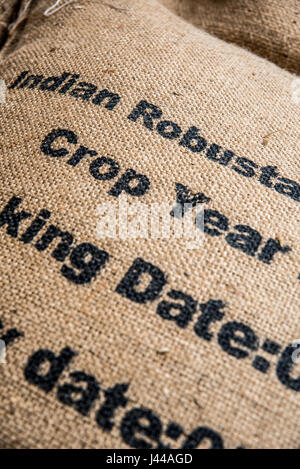 Sacks of coffee beans at a coffee importer's warehouse - Stock Photo