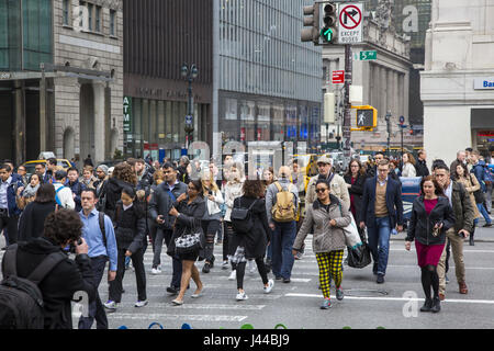 42nd Street at 5th Avenue is always crowded with pedestrian traffic in Manhattran, NYC. - Stock Photo