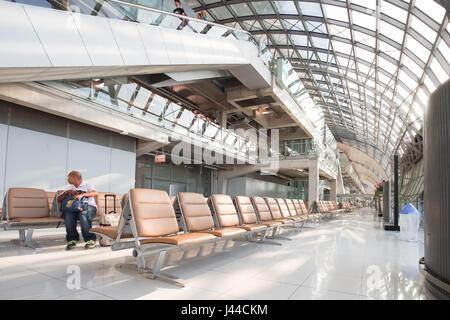 SAMUT PRAKAN, THAILAND - JANUARY 19, 2017: Travelers, passengers waiting flight in the terminal of Suvarnabhumi - Stock Photo