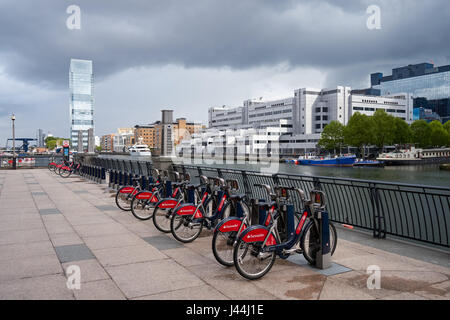 South Quay East Santander Cycles Hire docking station in Canary Wharf, London, England, United Kingdom, UK - Stock Photo